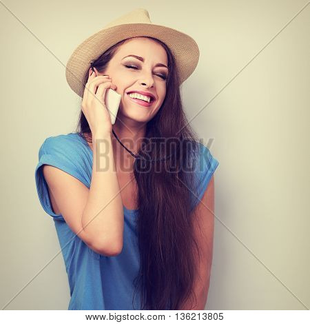 Beautiful Laughing Woman In Summer Hat Talking On Mobile Phone. Toned Closeup Portrait