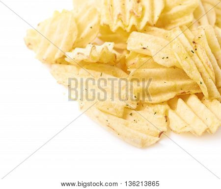 Pile of multiple seasoned potato chips crisps, composition isolated over the white background, close-up fragment crop