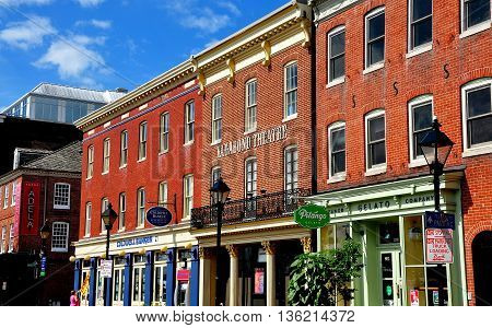 Baltimore Maryland - July 22 2013: The Vagabond Theatre along with specialty shops pubs and restaurants housed in 18th and 19th century buildings at historic Fells Point
