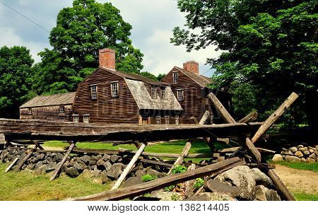 Lincoln Massacusetts - July 10 2013: A split rail fence stone walls and historic 1732 Hartwell Tavern at Minuteman National Historic Park