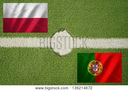 poland and portugal flag on football green field and haft line