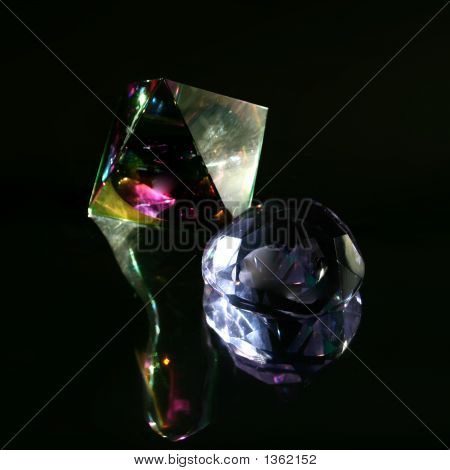 Prism And Faceted Glass Dome Against A Dark Chrome Background