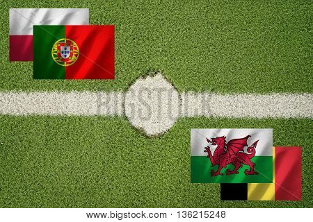 poland portugal belgium and wales flag on football green field and haft line - can use to display or montage on product or concept of challenge
