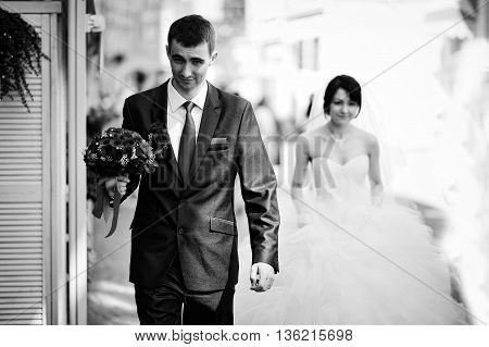 Groom Walk With Bouquet In Hand Background Bride
