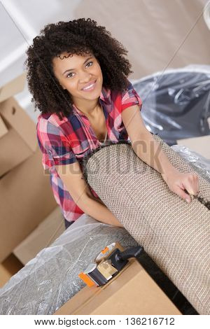 young woman moving in to new house