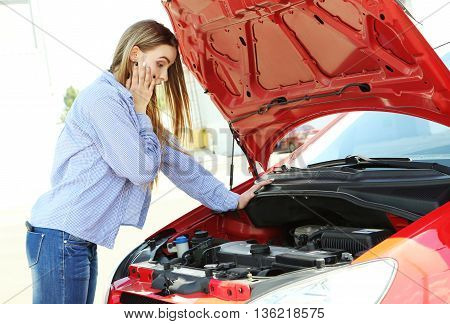 Beautiful Young Girl Open Hood Of Broken Car