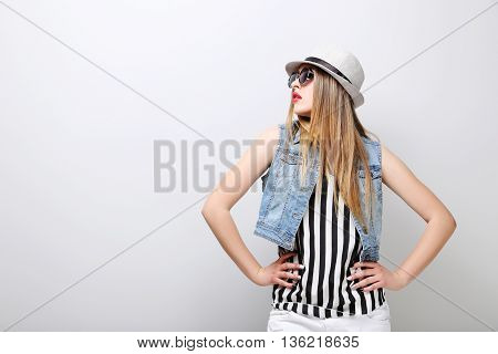 Portrait Of A Beautiful Hipster Girl On Grey Background
