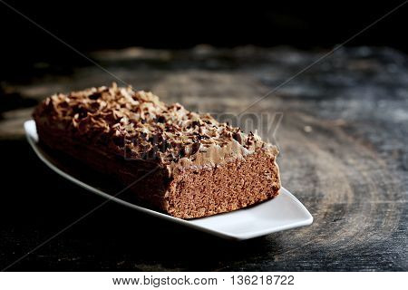 Chocolate Cake On A Black Wooden Background