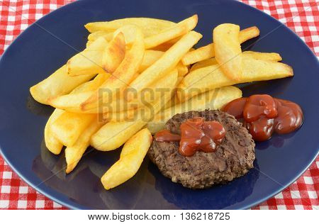 Hamburger and steak fries with catsup on blue plate