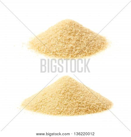 Pile of stevia cane sugar isolated over the white background, set of two different foreshortenings