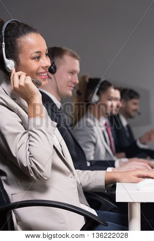 Call center employees during talking with a clients