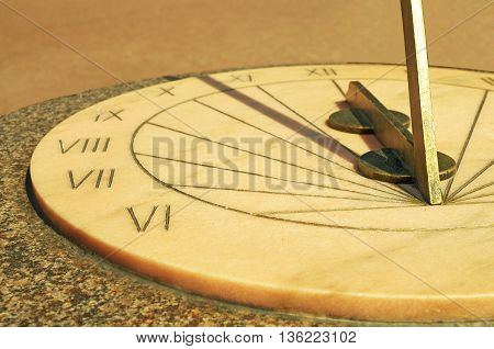Old historic design.a sundial tells the time by shadows from the sun.