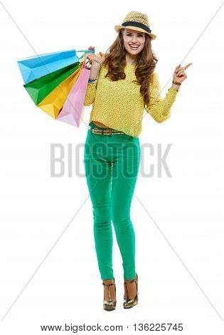 Woman With Shopping Bags Pointing Aside On White Background