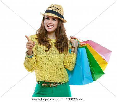 Happy Woman In Hat With Shopping Bags Pointing On Copy Space