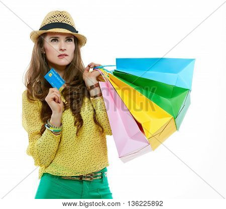 Portrait Of Thoughtful Woman With Shopping Bags And Credit Card