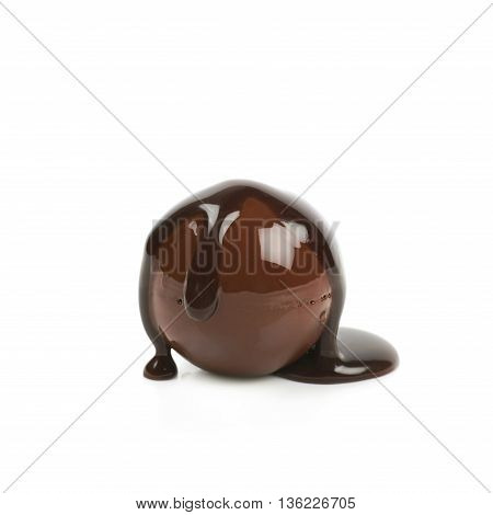 Chocolate ball candy coated with the hot liquid chocolate, composition isolated over the white background