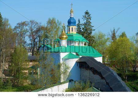 The view on the old Church, may sunny day. Svyato-Uspenskiy Pskovo-Pechersky monastery, Russia