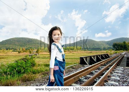 Girl Walk On The Railway
