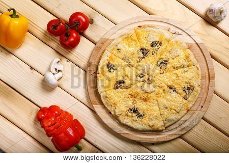 Italian pizza with onion, ham, bacon, mushrooms and olives