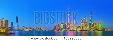Beautiful night Shanghai's cityscape with the city lights on the Huangpu River, Shanghai, China.