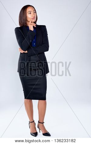Beautiful serious corporate business woman deep in thought, thinking