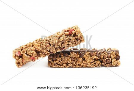 Pile of two nutrient chewy grains bars, composition isolated over the white background