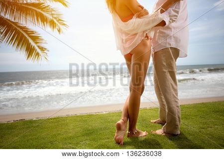 Couple on summer vacation standing on beach