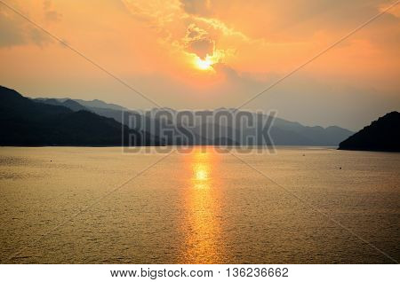 Beautiful landscape during sunset over a mountain ranges at lake in Srinakarin Dam Kanchanaburi Province Thailand