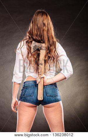 Strong Woman Feminist Holding Axe Behind Back.