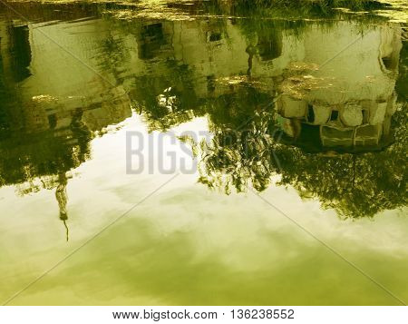 Reflection In The Water Of An Old Fortress