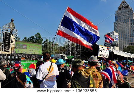 Bangkok Thailand - January 13 2014: Protestors listening to speeches at Lumphini Park carrying Thai flags at Operation Shut Down Bangkok *