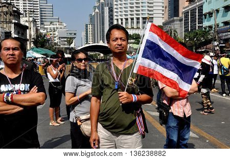 Bangkok Thailand - January 17 2014: Operation Shut Down Bangkok protestors marching at Asok