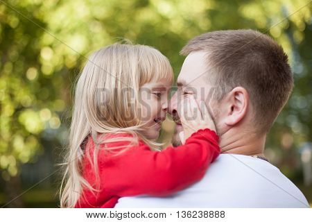 big dad little daughter nose to nose