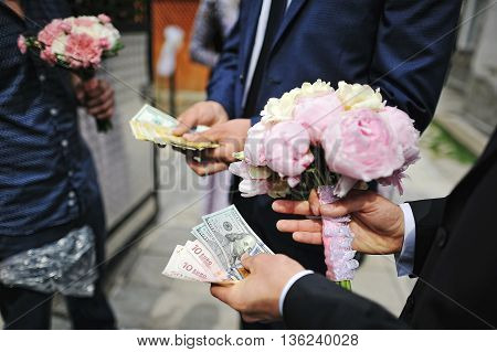 Wedding Bouquet Of Peony At Hands Of Groom With Moneys. Redemption Of Bride On Wedding