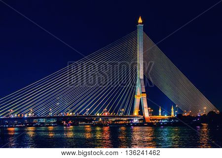 Rama VIII Bridge at night in Bangkok and Chao Phraya river Thailand