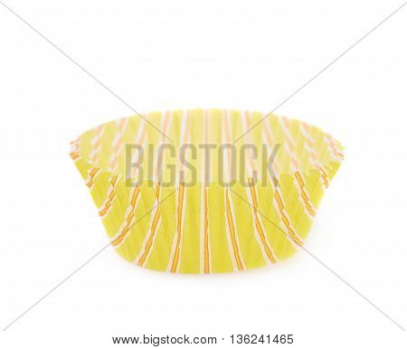 Single yellow paper cupcake cup isolated over the white background