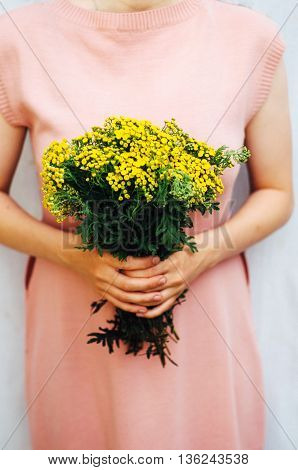 Young Woman In A Rosy Dress Holding A Bunch Of Colorful Picked W