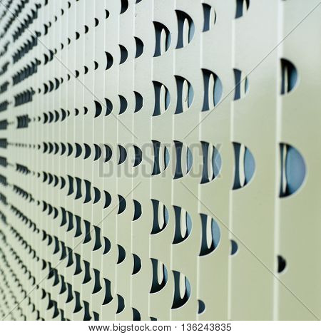 Wall protector made of perforated metal sheet, close-up fragment