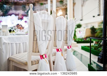 Wedding Chairs With Pink Bow And Brooch