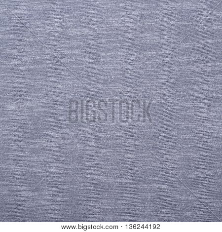 Fragment of a navy blue cotton cloth fabric material texture as an abstract background composition