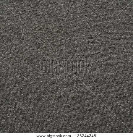 Fragment of a well worn gray cloth fabric material texture as an abstract background composition