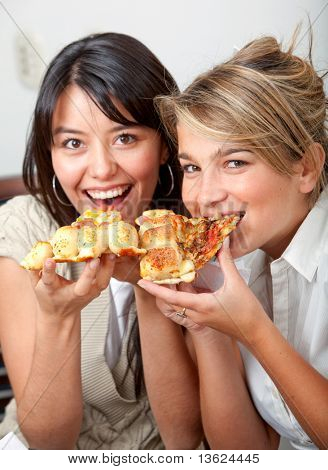 Beautiful girls eating pizza for lunch