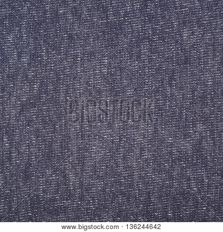Fragment of a dark blue linen cloth fabric material texture as an abstract background composition