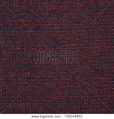 Fragment of a red and blue sweater's cloth fabric material texture as an abstract background composition