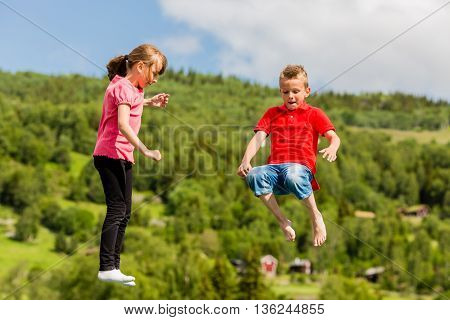 Kids Jumping On Bouncy Pillow