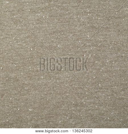 Fragment of a beige cloth fabric material texture as an abstract background composition