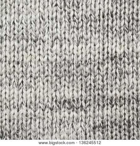 Fragment of a gray cloth fabric material texture as an abstract background composition