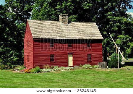 Woodbury Connecticut - September 15 2014: Circa 1680 Hurd House headquarters of the Old Woodbury Historical Society built entirely of wood with a central chimney