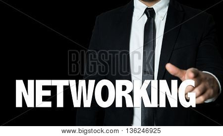 Business man pointing the text: Networking