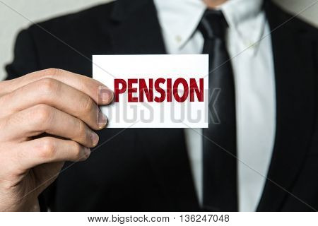Business man holding a card with the text: Pension
